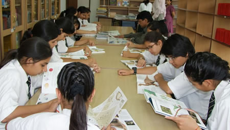 Student in library at Shigally Hill